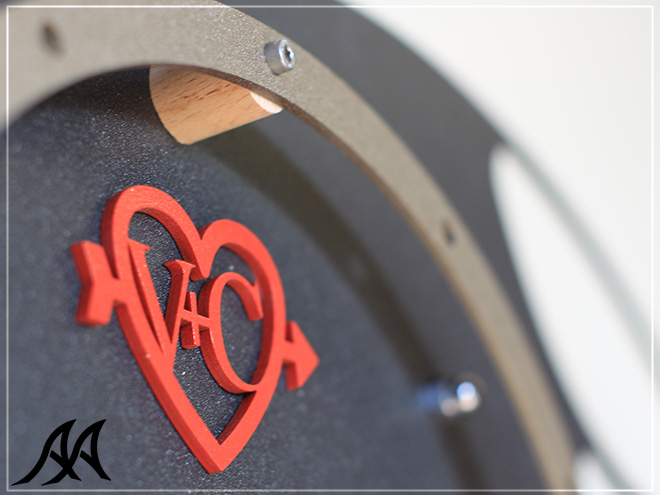 orologi-da-parete-abbraccio-arteacciaio-logo